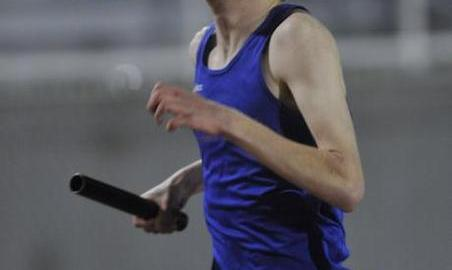 St. Joseph's Brian Hackman competes in the 4x400 relay at the West Central Coaches Invitational track meet on Friday.